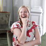 Woman sitting on a chair laughing